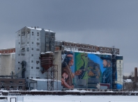 Those are storm clouds gathering over the grain elevators. More snow was coming.